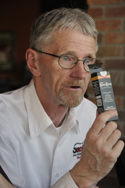Steve Gorham touts the benefits of e-cigarettes. His wife, Carrie, started the distributorship three years ago after throwing her last seven cigarettes into a mud puddle.