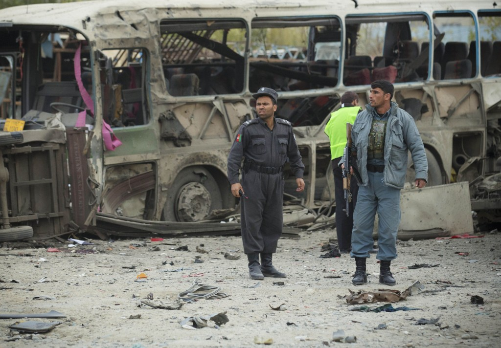 Afghan policemen secure the scene after a suicide vehicle bomb tore through Kabul on Saturday. The deadly bomb targeted a site where thousands of elders are to gather next week to discuss a controversial security agreement with the United States, which would allow U.S. troops to remain in Afghanistan after the final withdrawal of international combat troops at the end of 2014, officials said.