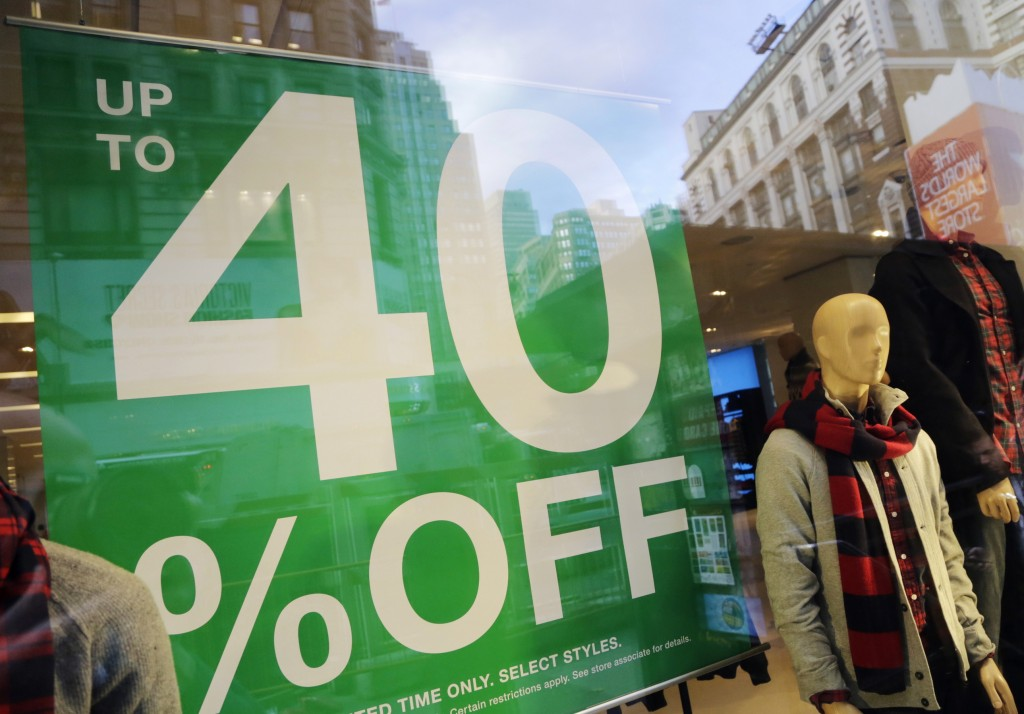 A pre-holiday sale sign is displayed at a Gap store in New York earlier this week. A retail trade group expects holiday sales to increase 3.9 percent this year.