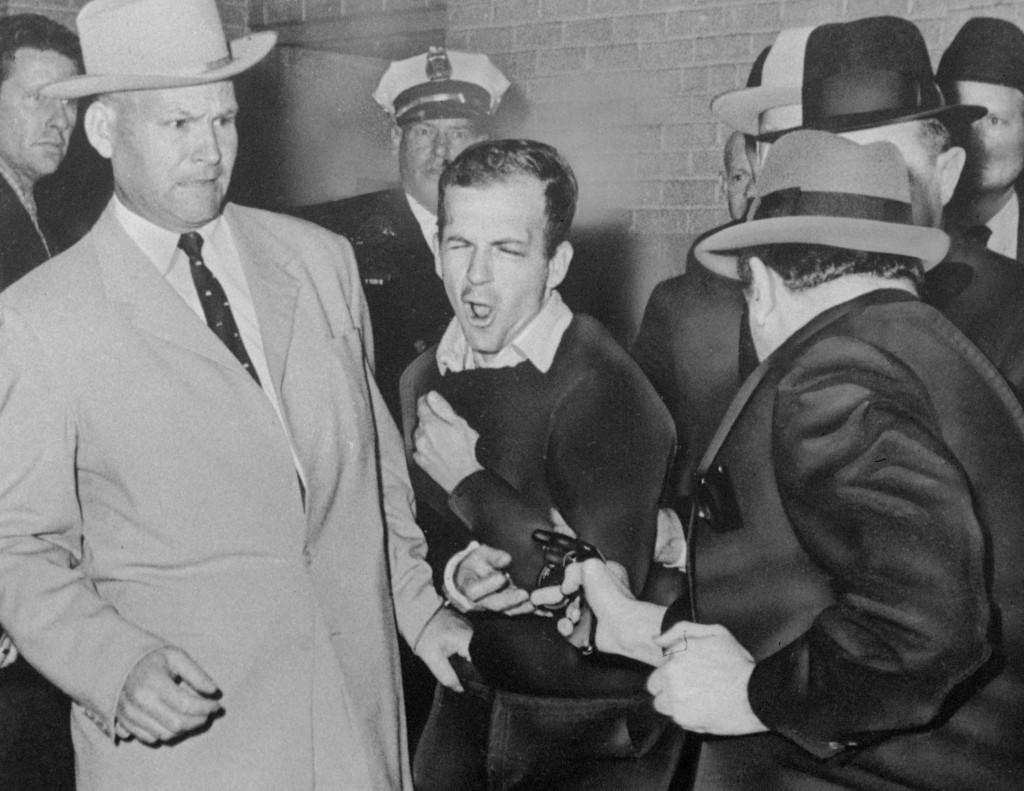 JFK assassin Lee Harvey Oswald, escorted by Detective James Leavelle, is shot in Dallas.