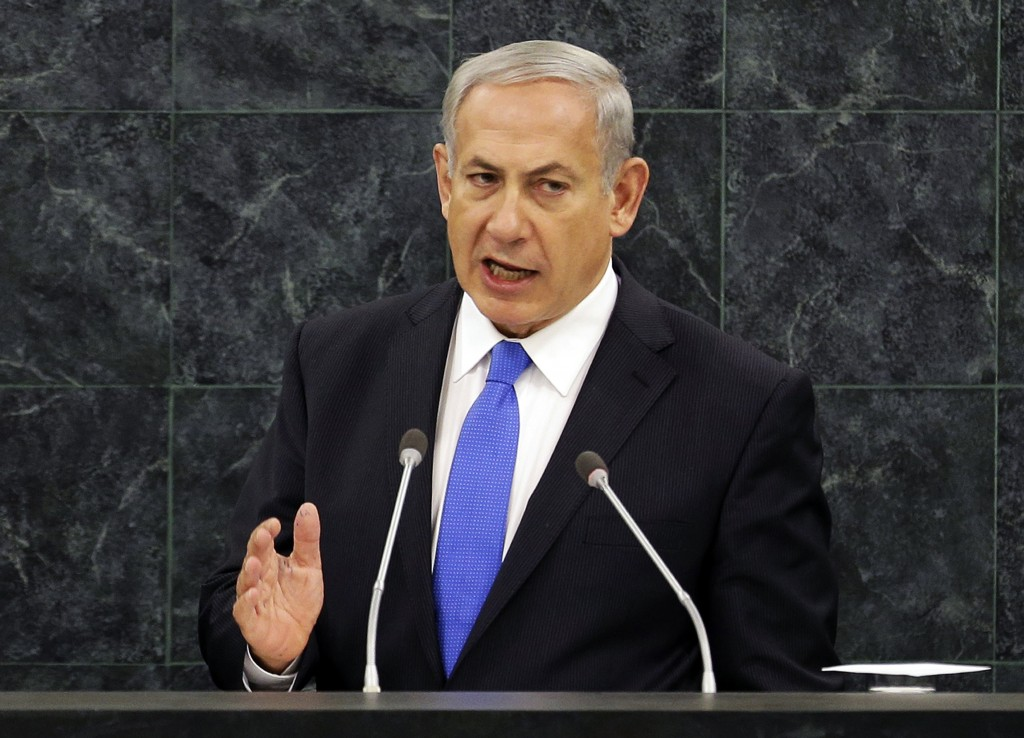 """FILE - In this Oct. 1, 2013, file photo, Israeli Prime Minister Benjamin Netanyahu speaks during the 68th session of the General Assembly at United Nations headquarters. The U.S. and Iran secretly engaged in high-level, face-to-face talks, at least three times over the past year, in a high stakes diplomatic gamble by the administration that paved the way for the historic deal aimed at slowing Iran's nuclear program. After a Sept. 27, phone call between President Barack Obama and Iranian president Hassan Rouhani, the U.S. began informing allies about the talks. Obama handled the most sensitive conversation himself, briefing Netanyahu during his Sept. 30 visit to the White House. The next day, in this speech to the U.N., Netanyahu blasted Rouhani as a""""wolf in sheep's clothing."""" (AP Photo/Seth Wenig, File)"""