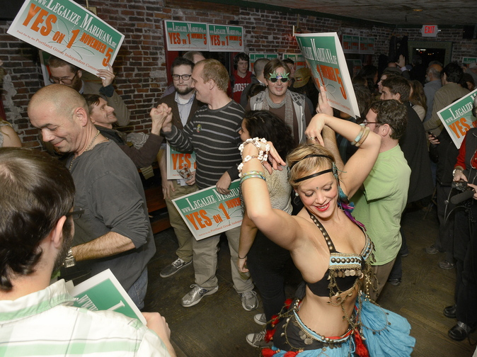 """Belly dancer Whitley """"Nabintu"""" Marshall dances to a reggae band as proponents of Portland's Yes on One celebrate Tuesday at Brian Boru in Portland."""
