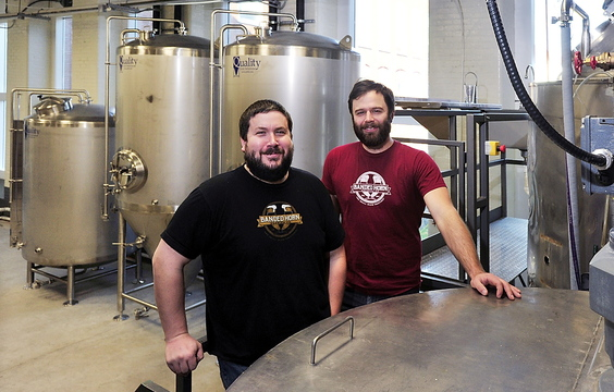 Ron Graves, left, and Ian McConnell stand amidst their stainless steel brewing equipment. They are set to open Banded Horn Brewing Co. as soon as this week. Biddeford's first brewery since the 1700s, has received enthusiastic support from the local community.