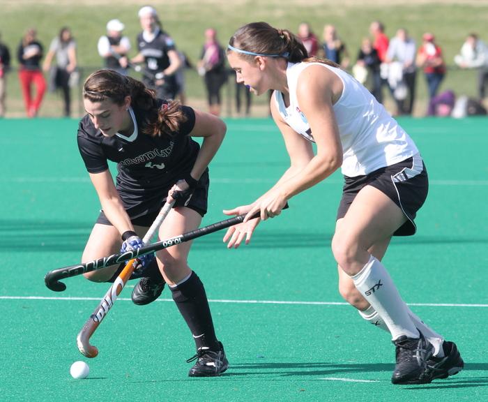 Bowdoin's Rachel Kennedy (18) and Christopher Newport University's Allie Hackbarth (15) battle for control over the ball during the NCAA Divison III semi-finals in Virginia Beach, Va. Bowdoin won 4-1.