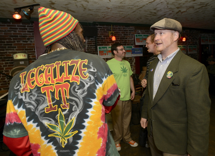 Stream Reggae band member Nyah Henderson talks with Portland city councilor David Marshall before the band played at the Yes on 1 campaign celebration at Brian Boru in Portland.