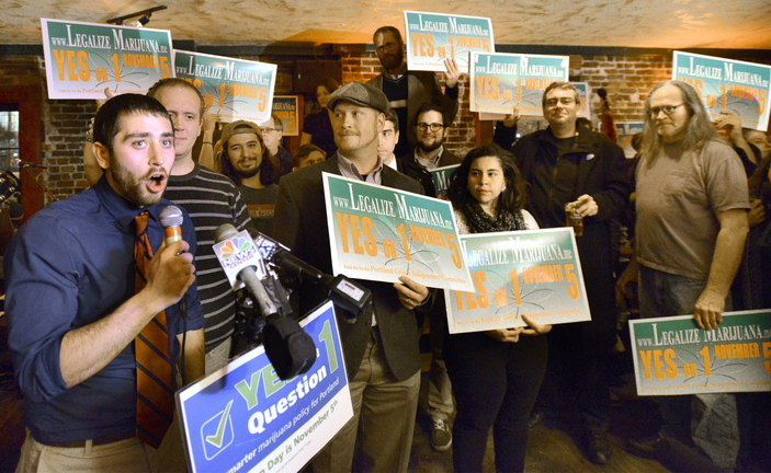 """David Boyer, Maine political director of the Marijuana Policy Project, speaks at Portland's """"Yes on 1"""" rally as they celebrate victory at Brian Boru in Portland."""