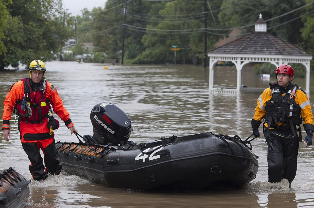 Fire rescuers go through a neighborhood in search of anyone in need in Austin, Texas, on Thursday, after heavy overnight rains brought flooding to the area.