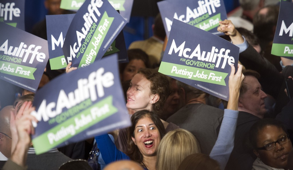Supporters celebrate the news that Democratic gubernatorial candidate Terry McAuliffe has been elected the next Governor of Virginia during the election night party in Tysons Corner, Va., Tuesday, Nov. 5, 2013.