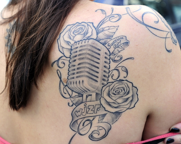 """Kristie Doyle shows the tattoo she obtained to honor her late uncle Dave Patterson, who founded the WJZF radio station and gave her the nickname """"Sunshine."""" Doyle has been working to keep the Standish-based station on the air for the past two years."""