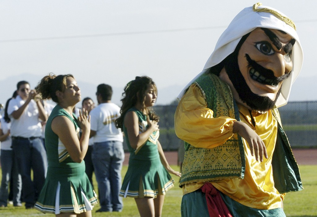 """Coachella Valley High School's mascot, """"Arab,"""" dances to the band during a pep rally at the school in Thermal, Calif. School officials in Southern California say the 'Arabs' are here to stay, but the costumed mascot that represents them may be changing."""