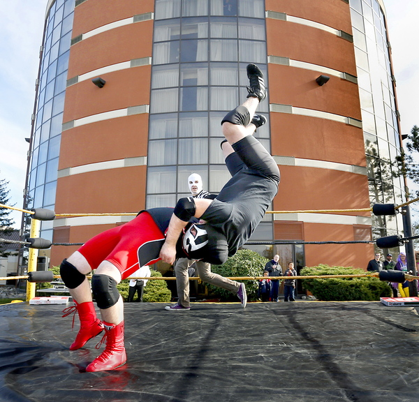 """Jacob """"Magnus Buho"""" Cote and Antoine """"Diablo Blanco"""" Malaab, both of Portland, wrestle in a match Saturday at Coast City Comicon. The convention also features artists, crafts people, music, dancing and horror films. It continues from 11 a.m. to 6 p.m. Sunday. Admission is $25."""