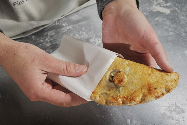 Warner's Portlander hand pie contains yellow onions, portobello mushrooms, rosemary, dried cranberries and local goat cheese.