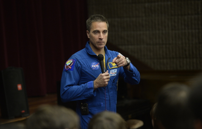 Astronaut Chris Cassidy speaks to students Monday at York High School, where he told stories of pranks, a spacewalk rescue and his acclimation to Earth after six months on the space station.