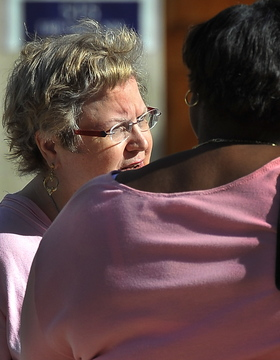 Martha Rigsby, left, speaks with attorney Vickey Wright-Smith as they leave court Wednesday.