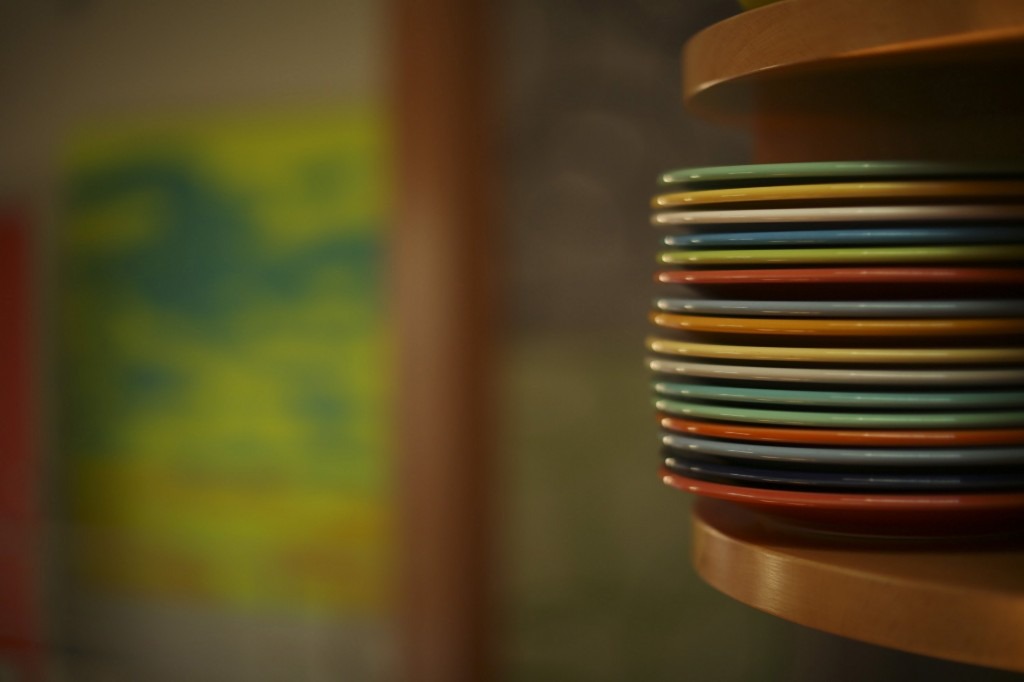 Curved corner cabinets display some of the couple's colorful Fiestaware and vintage collectibles.