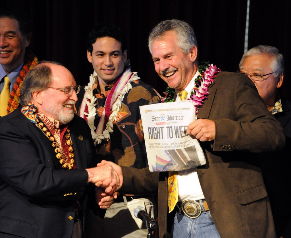 Gov. Neil Abercrombie, left, and former Sen. Avery Chumley celebrate after Abercrombie signed a bill legalizing gay marriage in Hawaii on Wednesday in Honolulu.
