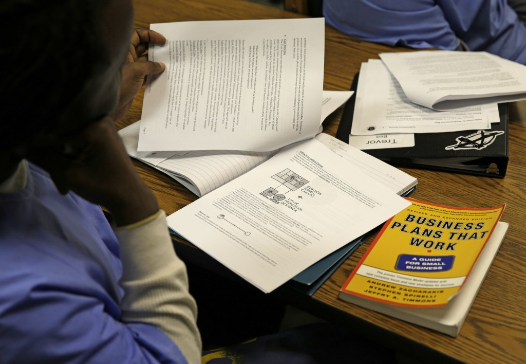 An inmate looks over materials on a business model canvas during a session of The Last Mile at San Quentin State Prison in San Quentin, Calif. Through twice-weekly sessions, the program provides information and practical experiences to foster inmates' confidence and a sense of hope that they can succeed as free men.