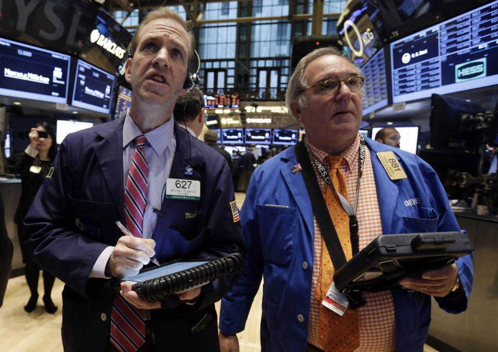 Traders Michael Smyth, left, and Eugene Mauro work on the floor of the New York Stock Exchange on Thursday.
