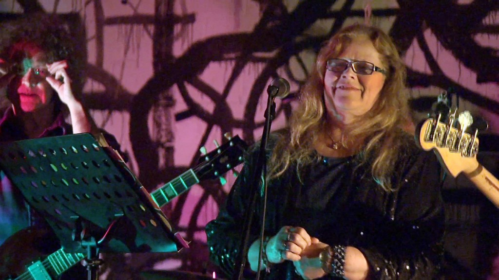 In this image taken from video Nov. 6, 2013, Dot Semprini as seen with the Dot Wiggin Band at the 285 Kent club in Brooklyn, N.Y. Semprini was one of the original members of The Shaggs, an obscure female band from Fremont, N.H. Now at 65 she has returned to the stage to sing to her loyal fans.