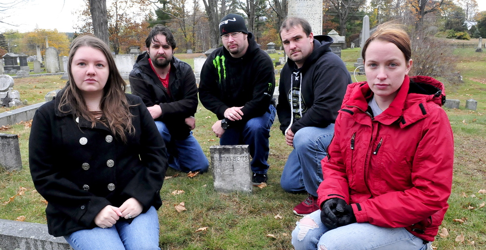Members of Paranormal Research and Extermination assemble at the Edward E. Mathews gravesite at Pine Grove Cemetery in Waterville recently. From left are Naomi and Kris Robinson, Jim Easler, Chris Clarke and Allie Turner.