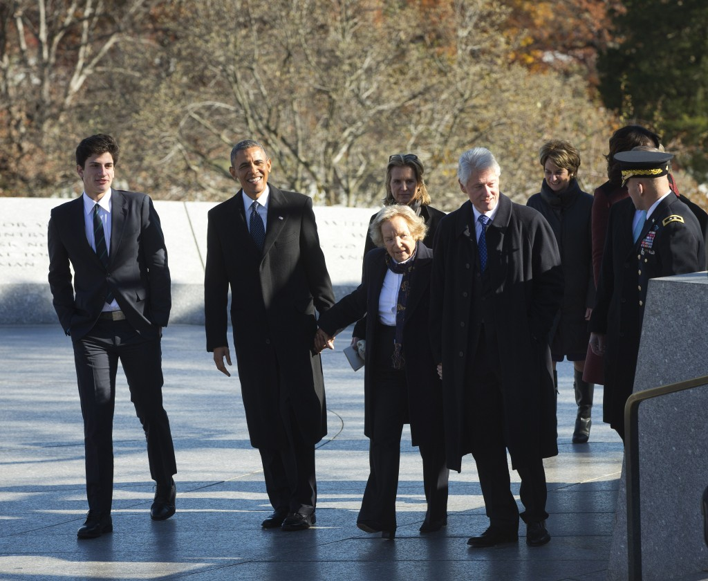 President Barack Obama and former President Bill Clinton hold hands with Ethel Kennedy, widow of Robert F. Kennedy, as they walk with members of the Kennedy family for a wreath laying ceremony in honor of President John F. Kennedy on Wednesday at the JFK gravesite at Arlington National Cemetery in Arlington, Va. On the far left is John Schlossberg, JFK's grandson.