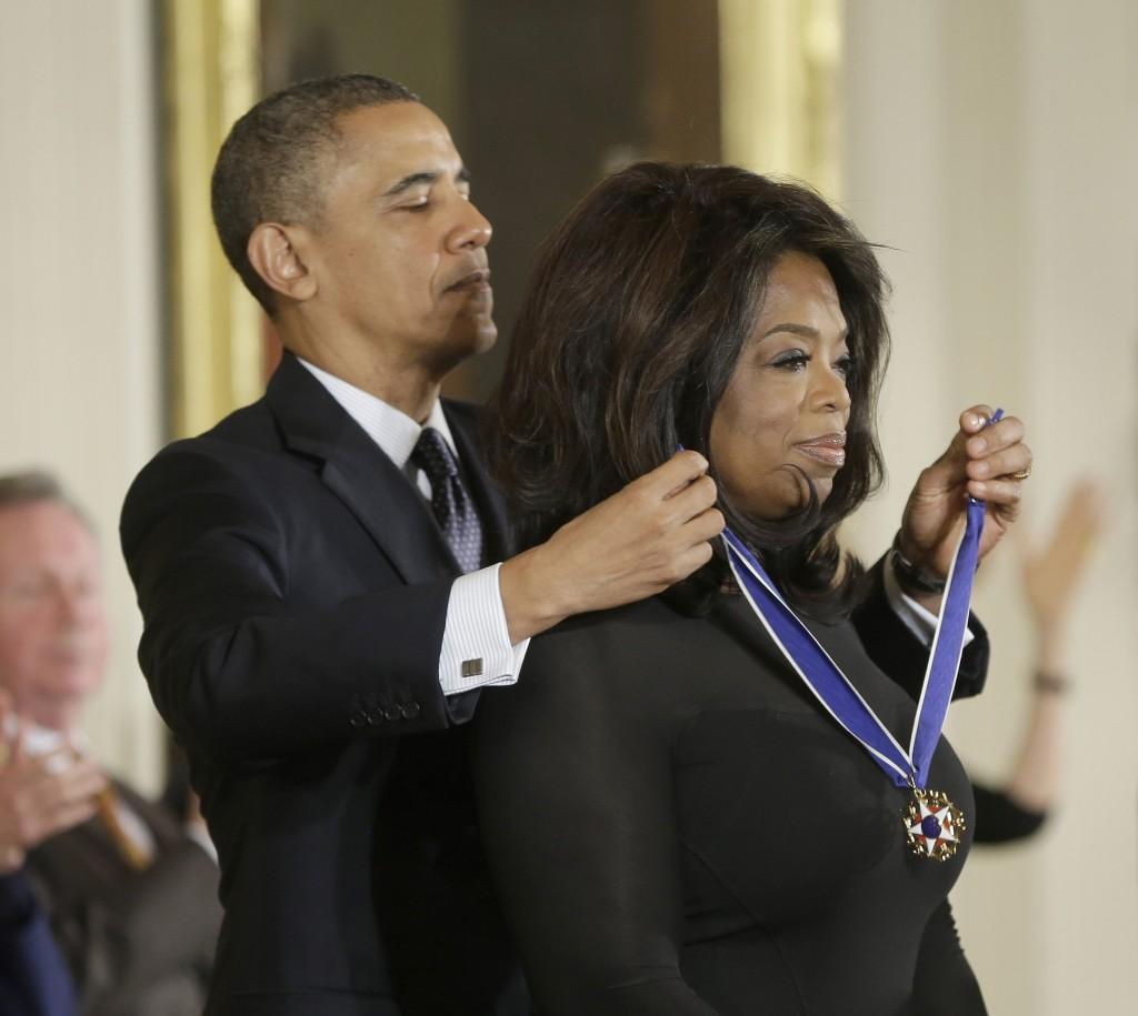President Barack Obama awards Oprah Winfrey the Presidential Medal of Freedom.