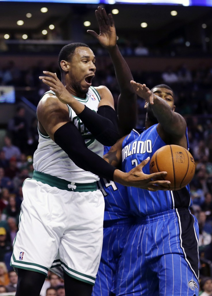 Boston's Jared Sullinger scoops a pass under the pressure of Orlando's Kyle O'Quinn, as the Celtics used crisp passing and shooting to beat the Magic 120-105 at Boston on Monday.