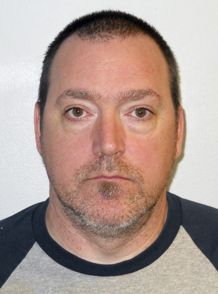 This booking photo released by the Concord Police Department shows Raymond Stevens, of Pembroke, N.H. Stevens, accused of scrawling racist graffiti on the homes of African immigrants in Concord is hospitalized after shooting himself in the head, court records show.