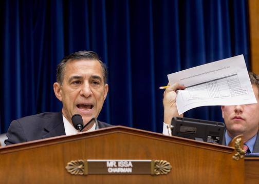 House Oversight Committee Chairman Rep. Darrell Issa, R-Calif., holds up a checklist related to the implementation of the HealthCare.gov website, during a hearing on Capitol Hill Wednesday. Issa wanted to know why the administration required consumers to first create online accounts before they could shop for health plans, a decision that runs counter to the common e-commerce practice of allowing anonymous window-shopping.