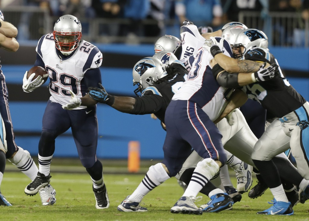 New England Patriots' LeGarrette Blount (29) runs past the Carolina Panthers during the second half Monday night's game in Charlotte, N.C.