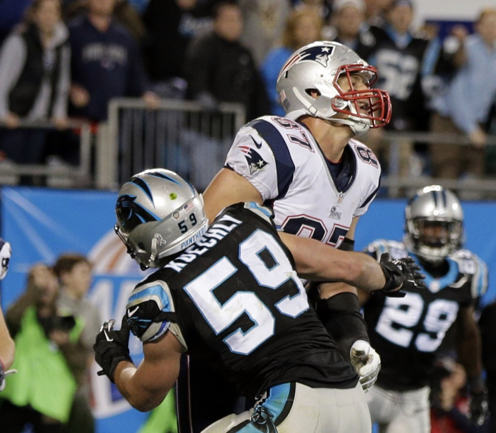 Luke Kuechly, 59, blocks Rob Gronkowski of the Patriots on the final play Monday night. A penalty flag was thrown for pass interference, but after a brief huddle, the officials waved off the penalty and the Panthers won, 24-20.
