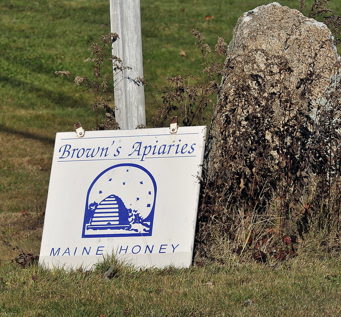 A sign by the road aims to attract honey buyers to Stan Brown's farm in North Yarmouth.