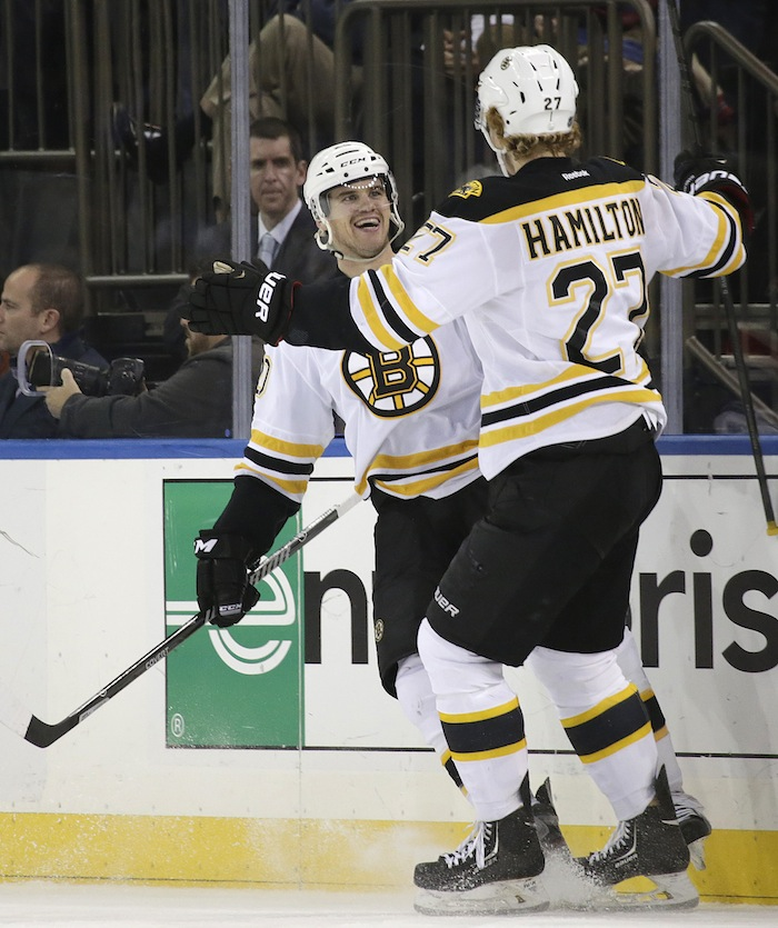 Boston Bruins left wing Daniel Paille (20) celebrates with Bruins defenseman Dougie Hamilton (27) after scoring a goal in the second period of their NHL hockey game at Madison Square Garden in New York, Tuesday, Nov. 19, 2013. The Bruins defeated the rangers 2-1.