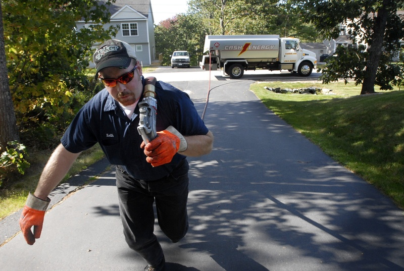 Keith Franklin of Cash Energy delivers heating oil to a home in Old Orchard Beach. Because the federal government is unable to pass a budget, the Low Income Heating Assistance Program, known as LIHEAP, keeps the people who depend on it in constant suspense.