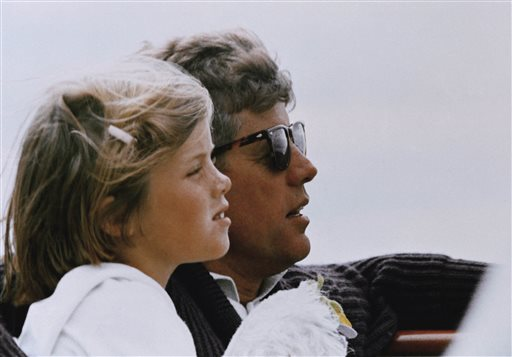 In this 1962 file photo, President John F. Kennedy and his daughter, Caroline, sail off Hyannis Port, Mass. Away;Bonding;Childhood;Close-Up;Leadership;Looking;sailing