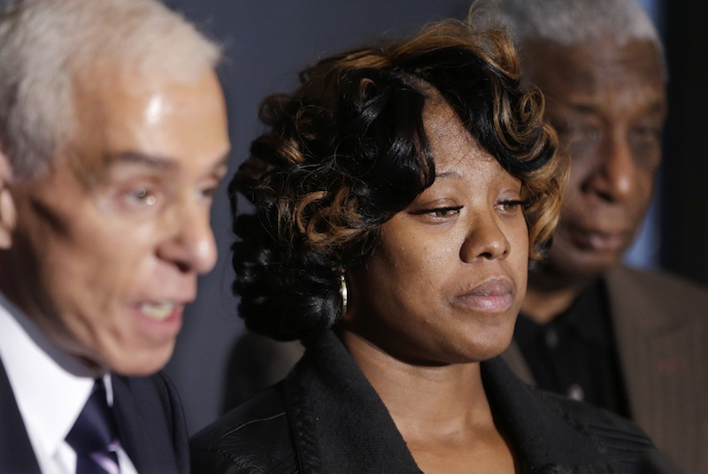 Monica McBride, center, is seen with attorney Gerald Thurswell, left, and spokesman Ron Scott, right, during a news conference in Southfield, Mich., Friday, Nov. 15, 2013. Monica's daughter, Renisha McBride, was shot on Nov. 2 in the face on Theodore P. Wafer's front porch in Dearborn Heights.