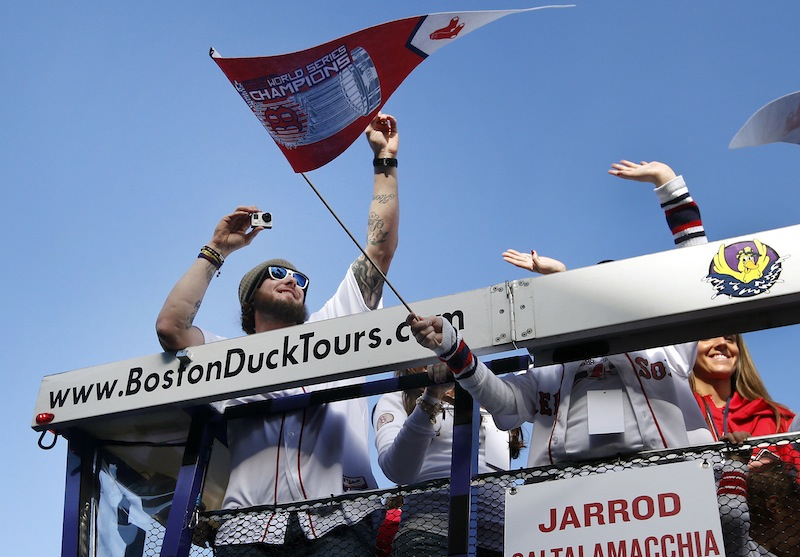 Boston Red Sox catcher Jarrod Saltalamacchia takes pictures as he rides in a duck boat during a rolling rally in Boston, Saturday, Nov. 2, 2013 to celebrate their World Series championship. What to do with Saltalamacchia and the catcher's position is one of the major questions facing the Red Sox this offseason. Saltalamacchia has a major offense slump in the postseason and was replaced during the World Series.