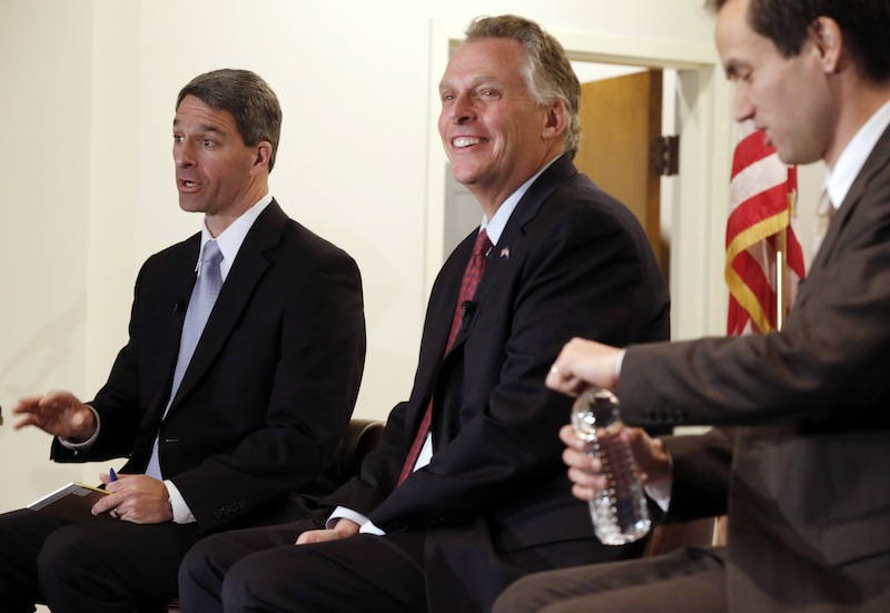 Candidates for the Virginia governor seat Ken Cuccinelli, left, Terry McAuliffe, center, Robert Sarvis, right, participate in a community forum at the Virginia War Memorial in Richmond, Va., on Saturday, Oct. 26, 2013.