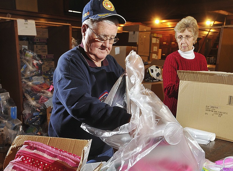Volunteers Walter and Nina Braley of Standish prepare a Bruce Roberts Toy Fund gift bag in 2010. A reader calls for more stories about the 2013 effort, which is now called the Press Herald Toy Fund.