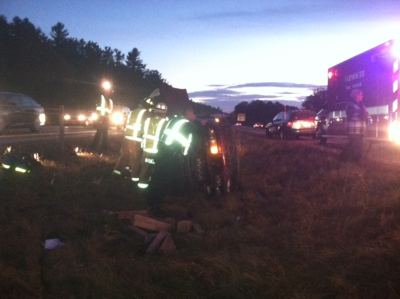 Maine State Troopers attend to an overturned car Thursday night after an alleged hit-and-run crash on I-295 South in Cumberland, Maine.