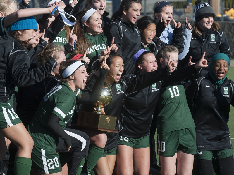 Waynflete girls soccer players celebrate their victory in the Class C state championship game in Hampden, Maine Saturday, Nov. 9, 2013.