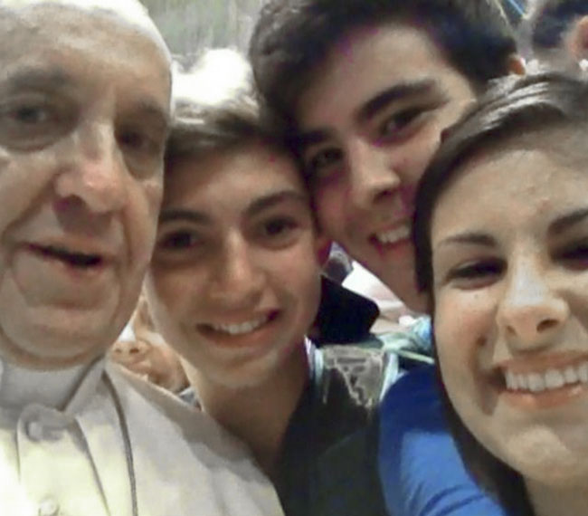 "Pope Francis has a ""selfie"" taken inside St. Peter's Basilica with youths from the Italian Diocese of Piacenza and Bobbio who came to Rome for a pilgrimage."