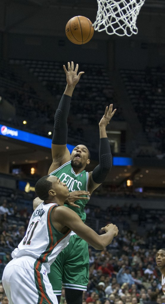 Jared Sullinger, who scored 21 points Saturday night for the Boston Celtics, lifts a shot over John Henson of the Milwaukee Bucks during the Bucks' 92-85 victory.