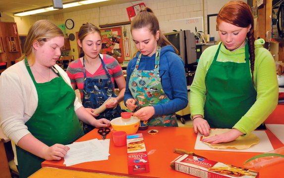 Skowhegan Area High School students in the basic foods class prepare to make pizza pockets. They are, from left: Emily Greaney, Mariah Bonneau, Laura Wolters and Monique Thompson.