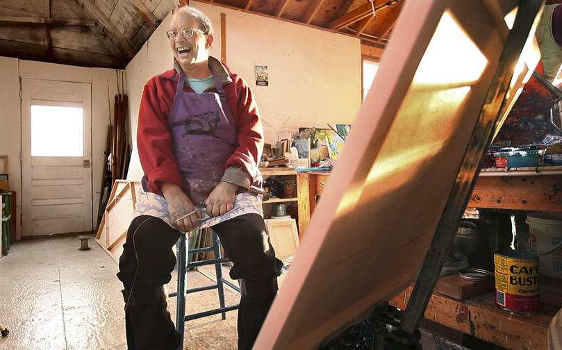 """Stricken by amyotrophic lateral sclerosis – more familiarly known as Lou Gehrig's disease – Jon Imber keeps up his sense of humor and energy in his studio in Stonington last month. """"I found out that (painting) really means a lot to me, so I want to keep doing it,"""" says the 63-year-old artist, who adds that he has never felt better about his work."""