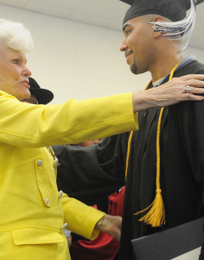 Maine State Prison inmate Sergio Hairston hugs philanthropist Doris Buffett after receiving a diploma from the University of Maine at Augusta during a ceremony Nov. 4 at the state correctional institution in Warren. Buffett, the sister of Warren Buffett, founded the Sunshine Lady Foundation, which supports educating inmates across the United States.