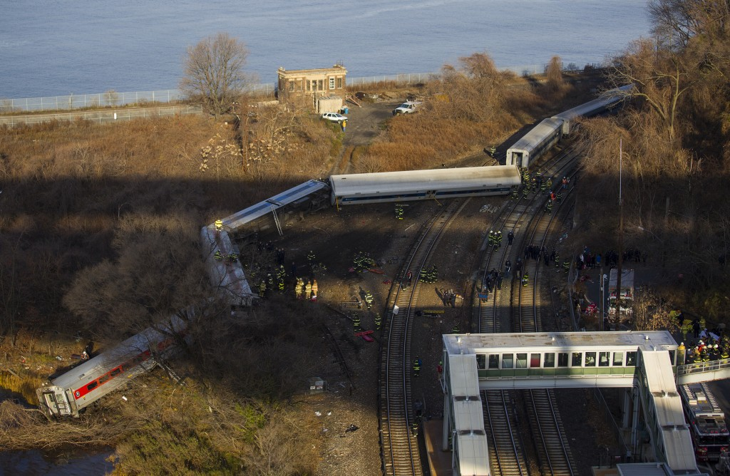 First responders gather around the derailed Metro-North passenger train in the Bronx borough of New York on Sunday.