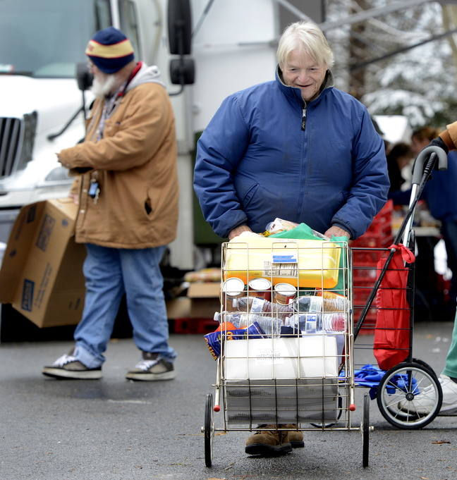 Donna Young of Woolwich pushes her cart after visiting the food truck.