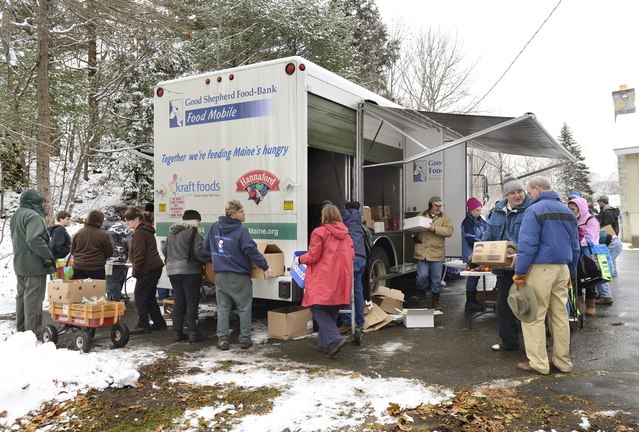 A line forms around the mobile food truck behind the Grace Episcopal Church in Bath on Tuesday.
