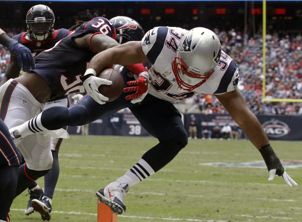 New England Patriots' Shane Vereen (34) is knocked out of bounds at the 1-yard line by Houston Texans' D.J. Swearinger (36) during the third quarter Sunday in Houston.